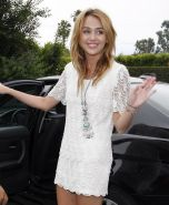 Miley Cyrus leggy wearing white mini dress at the house party