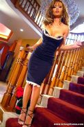 Crissy Moran Posing Her Hot Curves By The Stairs