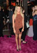 Ashley Tisdale wearing tight patterned orange mini dress at Spring Breakers prem