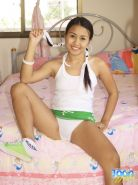 beautiful thai babe upskirt flashes her shaved pussy