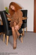 Redhead mature lady Claire in brown stockings