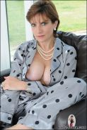 English busty mature in silk pyjamas masturbating