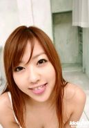 Petite japanese teen playing on her bed