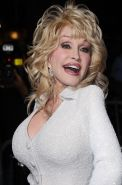Dolly Parton busty wearing tight white dress at the 'Joyful Noise' premiere in L