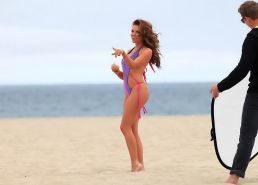 Kayla Collins exposing her curvy bikini body while shooting at the beach