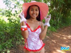 Thai girl in lingerie and hat outdoors