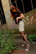 Redhead Justine in nylons outdoors