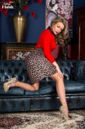 Penny in her leopard print stilettos and skirt and retro lingeri