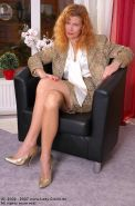German redhead lady Claire in silky stockings