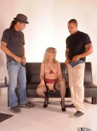 MILF Nina Hartley takes white and black cock in threeway sex