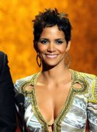 Halle Berry shows cleavage  belly button wearing wide open dress at 42nd NAACP I