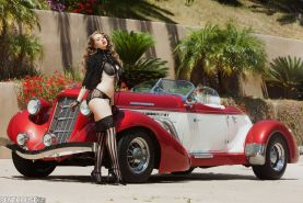 Jessi June strips and masturbates by a classic car