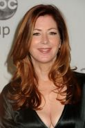 Dana Delany showing huge cleavage at the photocall in Beverly Hills