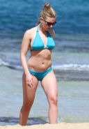 Scarlett Johansson busty wearing sky blue bikini on a Hawaiian beach