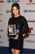 Eva Longoria leggy wearing a tight black mini dress at Telemundo's Premios Tu Mu