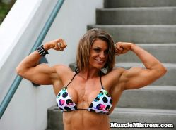 Fitness Mistress with big bodybuilder muscles