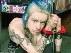 Tattoo punk gets stripped and chained up