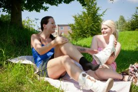 Real lesbian amateur teens licking outdoor in a city park