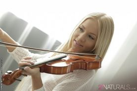 Kiara Lord hot blonde playing the violin and fingers her shaved pussy