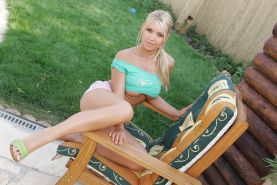 Beautiful busty blonde teen babe strips and poses in sunshine