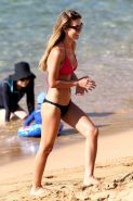 Audrina Patridge showing off her bikini body on a Hawaiian beach