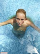 Gorgeous nude erotic fashion model in pool