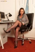 Secretary Marlyn Lindsay in the office in her black pantyhose