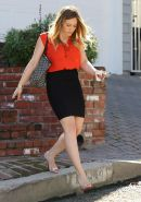 Hilary Duff busty wearing red see-through to bra top  black mini skirt out in St