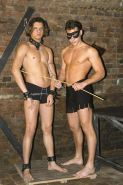 A mask hunk with a whip sucking and fucking his bud in a dungeon