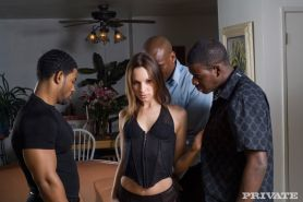 Amber Rayne loves black dicks and is fucked by a gang crew
