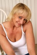 Horny blonde mature shows off her shaved pussy