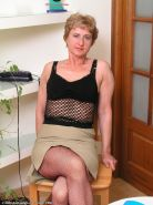 Granny in fishnet stockings shows off her big hairy pussy