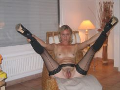 Amateur mature wife toying with vegetables at home