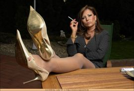 Smoking german lady wearing stockings and golden heels