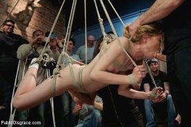 Emma Haize petite blonde suspended and fucked with an audience by John Strong an