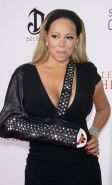 Mariah Carey cleavy with her broken arm in tight black mini dress at The Butler