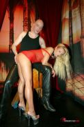 Kinky blonde in red fishnet gets pussy tortured and tits waxed