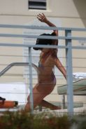 Eva Longoria caught in a tiny colorful bikini poolside in Miami