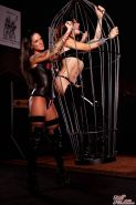 Kayla Jane gets kinky with Melodie Gore in the dungeon