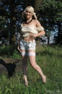 Shy glamour teen in white fishnets outdoors