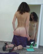 Little housemaid wiping a mirror naked