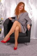 Redhead Lady Claire posing in tan pantyhose
