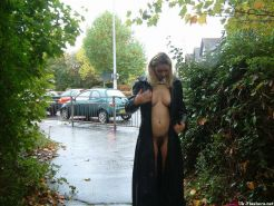Busty mature babe Emma Louise nude in public and showing hairy pussy the exhibit