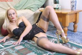 Very hot blonde shows off her stockings and pussy