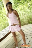 Innocent teen babe Tussinee poses and gets naked outdoors
