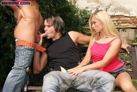 Bisexual guys and a hot babe in a MMF 3way