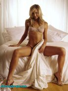 Stacy Keibler posing all naked and in black fishnet stockings