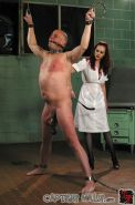 Mean redheaded femdom administering extreme cbt punishment