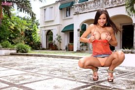 Sexy big breasted Janessa Brazil posing outdoors