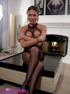 Transsexual Mia Isabella posing in exclusive fishnet catsuit